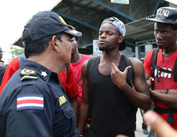 Costa Rican official talks with African migrants