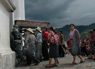 Funeral in Chichicastenango. by Dan Alder