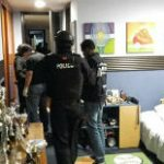 Ecuador police raid alleged illegal gold network