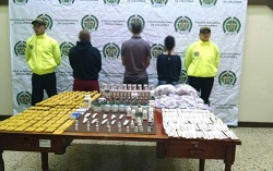A police photo of the detainees and fake medicine