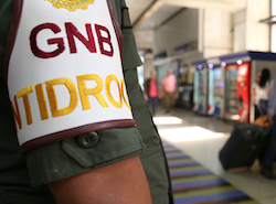 A Venezuelan National Guard member stands watch at an airport