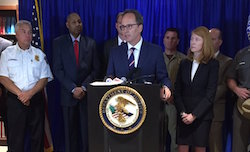 US Attorney William Hochul announcing the charges