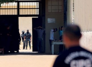 Security forces at the scene of a recent prison gang confrontation