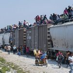 "Migrants riding the dangerous Mexican train dubbed ""The Beast"""