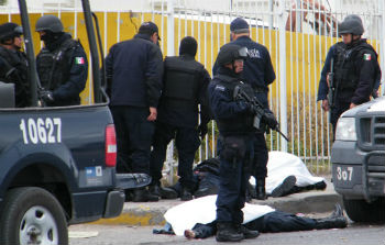 Police guard a crime scene in Ciudad Juárez