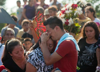 A grieving family in El Salvador