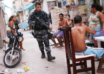A policeman patrolling a favela in Rio de Janeiro