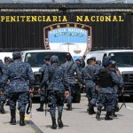Prison guards walk into Honduras's Támara prison