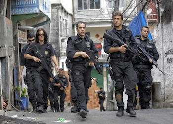Police forces patrol a favela in Rio de Janeiro