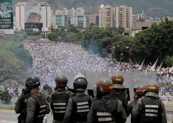Venezuela security forces watch demonstrating protestors