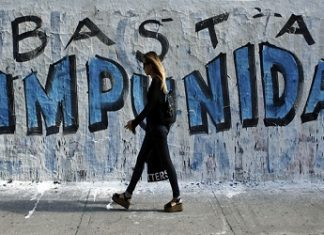 Graffiti calling for an end to impunity