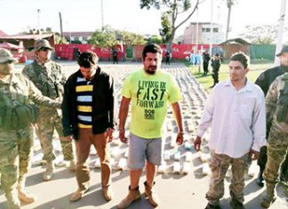 Paraguayan political figure Fredy Alberto Godoy Segovia, center, arrested in Bolivia
