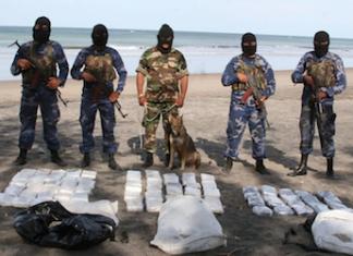 Nicaragua security forces guard a seized drug shipment